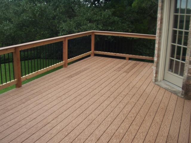 An image of an elevated wooden deck with a door that exits to the deck.